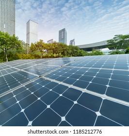 Ecological energy renewable solar panel plant with urban landscape landmarks