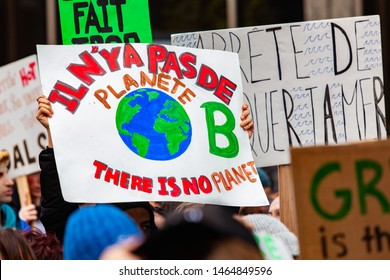 Ecological protestors march for change. There is no planet b is shown on a homemade placard held by ecological demonstrators during a peaceful march in a city center.