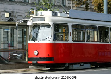 ecological red tram carries passengers for European cities