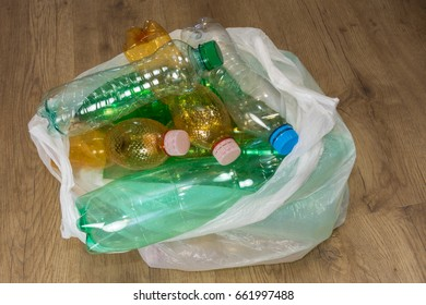 Ecological separation of household waste. Empty pet bottles in a plastic bag.