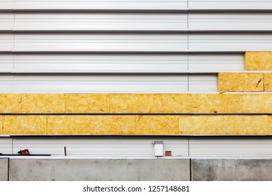 Ecological thermal insulation of an industrial façade
