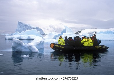 Ecological tourists in inflatable Zodiac boat in Paradise Harbor, Antarctica