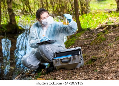 ecologist biologist with a sample of water samples from a forest lake