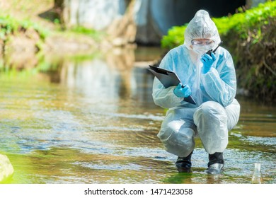 ecologist scientist while conducting research on sewage contamination