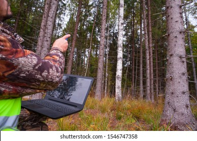 Ecologist is watching the forest. Forestry and afforestation. Computer technologies in forestry.