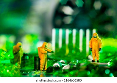 The ecologists or technicians cleaning toxic or radioactive waste on motherboard.  Environment pollution concept. Selective focus.