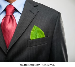 Ecology concept, businessman keeping a green leaf in his pocket