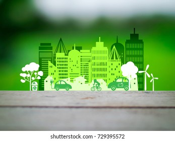 Ecology concept ;green car with windmill  in the city in Paper Cut Style on white background,Ecology concept art