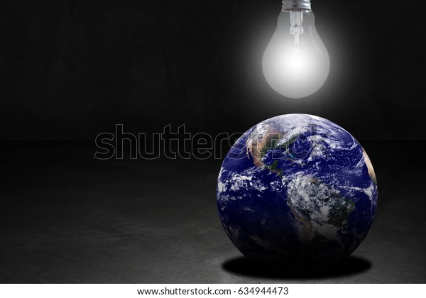 Ecology concept, save energy, the earth and light bulb on dark background, Elements of this image furnished by NASA