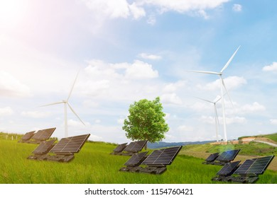 Ecology concept tree electrical energy clean wind turbine and solar cell the future