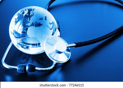 ecology eco environment or global warming concept with glass globe and stethoscope