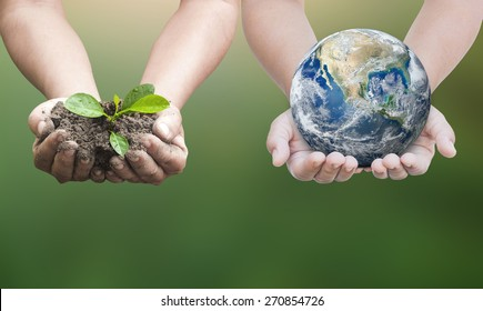 Ecology network concept: Two human hands holding young plant with soil and planet on blur green nature background. Elements of this image furnished by NASA.