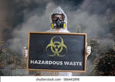 Ecology and pollution concept. Man in coveralls is warning against hazardous waste.