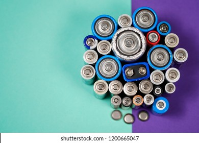 Ecology recycling concept. Many different types used or new battery, rechargeable accumulator, alkaline batteries on color background. Nature energy