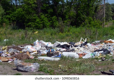 Ecology of Ukraine. Nature near Ukrainian capital.Environmental contamination. Illegal junk dump. May 23, 2018.Near Kiev, Ukraine