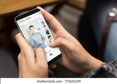 e-commerce concept: girl using a digital generated phone with shop online on the screen. All screen graphics are made up.
