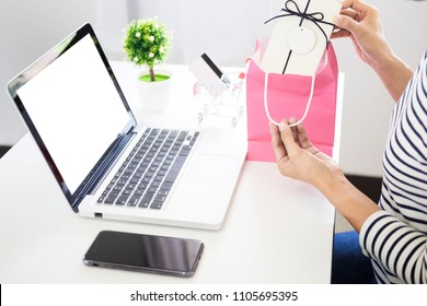 e-commerce delivery concept and online selling start up small business owner packing in the card box at workplace. freelance woman seller prepare product for packaging process at shop.