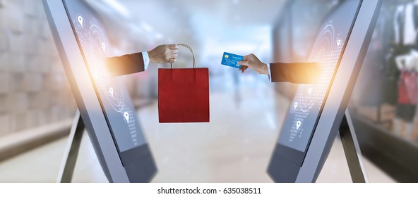 e-commerce, hand holding shopping bag and credit card from screen and global network, shopping and payments online concept, all on credit card are design up