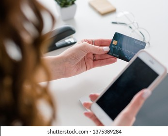 E-commerce payment. Online banking. Smartphone and credit card for making transaction. Safe and secure method.
