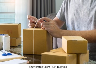 e-commerce shopping company concept, business entrepreneur seller prepares the delivery box for the customer