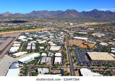 Economic growth in Scottsdale, Arizona along the Loop 101 freeway and the airport viewed from above