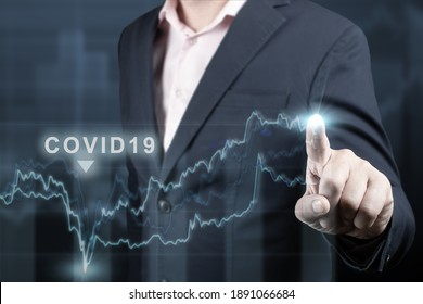 economic recovery after the fall due to the covid 19 coronavirus pandemic. Double exposure of financial graph. Businessman pointing graph corporate future growth plan on dark blue