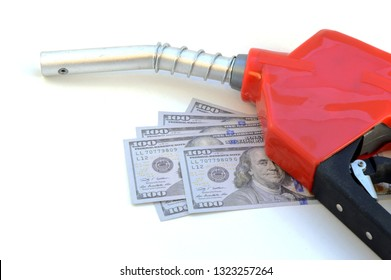 Economical concept of American dollars with a red gas nozzle for the rising cost of pumping gasoline.