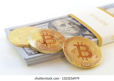 Economical concept based on the digital currency cryptocurrency bitcoin with some American cash money over a white background.