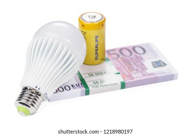 economical led lamp and yellow battery on a pack of euro money isolated on white background