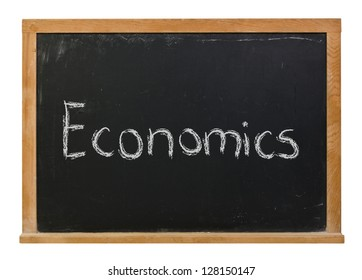 Economics written in white chalk on a black chalkboard isolated on white