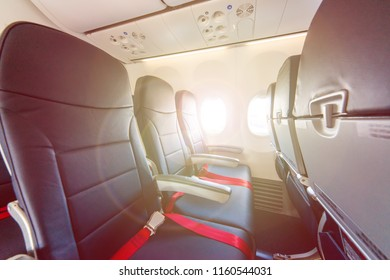 Economy class cabin in a modern civil airplane.