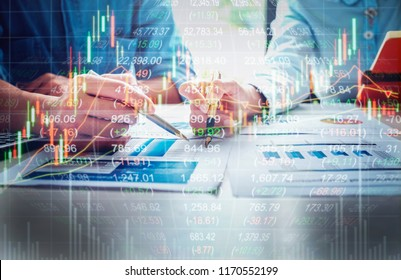 economy concept, business man and businesswoman pen pointing stock marketing graph chart to analyze finance data stock.