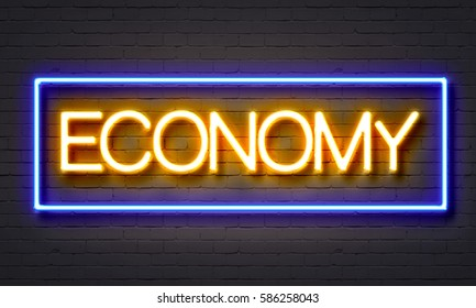 Economy neon sign on brick wall background