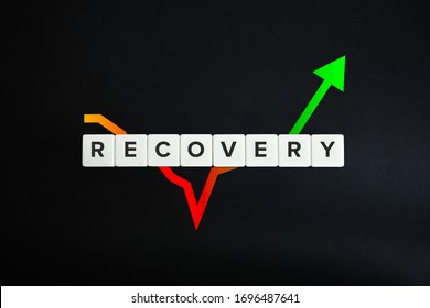 Economy recovery concept. Financial, industrial, business and market sector comeback and upturn. Block letters on black background.