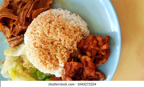 economy rice / mixed vegetable rice with meat, bean curd and cabbage, a staple food in singapore. chap chai peng