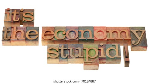 It's the economy stupid, a slogan from Bill Clinton presidential campaign  in vintage wooden letterpress printing blocks, stained by color inks, isolated on white