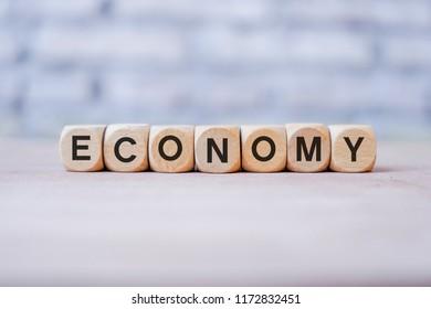 Economy word written on wood block