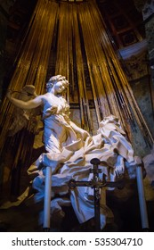 The Ecstasy of Saint Teresa is the central sculptural group in marble set in an aedicule in the Cornaro Chapel,Santa Maria della Vittoria, Rome,Italy. It was completed by Gian Lorenzo Bernini in 1652.