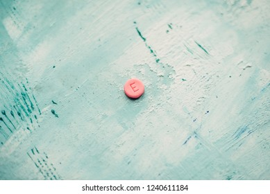 ecstasy tablet on a blue background