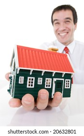 Ecstatic businessman holding a miniature house - isolated