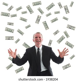 Ecstatic businessman surrounded by US dollars.