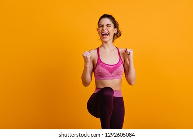Ecstatic woman doing zumba. Enchanting girl enjoying training.