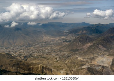 Ecuador, Pichincha, Quito. Aerial photograph of Quito suburbs and surrounding countryside