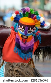Ecuador, Pichincha, Quito. Man doing traditional dance while Quito celebrates the anniversary of its Spanish foundation, Plaza de Santo Domingo