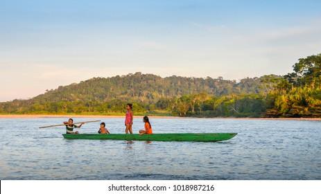 Ecuadorian Amazon, December 31st 2017: Local Quechua tribe teenagers in the Ecuadorian Amazon on a canoe on the river Napo