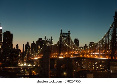 The Ed Koch Queensboro Bridge a cantilever bridge over the East River at twilight in New York City, USA.