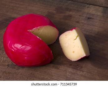 Edam cheese on wooden background