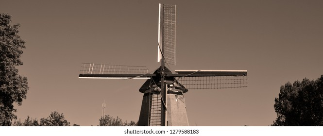 EDAM NETHERLAND OCTOBER 01 2015: Windmill in Edam is a city in the northwest Netherlands, in the province of North Holland. Combined with Volendam, Edam forms the municipality of Edam Volendam.
