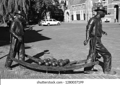 EDAM NETHERLAND OCTOBER 01 2015: Statue of cheese carriers at the cheese market in Edam, Netherlands