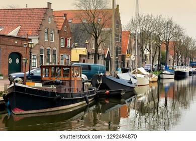 EDAM, NETHERLANDS - APRIL 14, 2018: Houses and boats on the canal in a small city Edam in Netherlands. Edam is a small village in the district Nordholland, Netherlands.